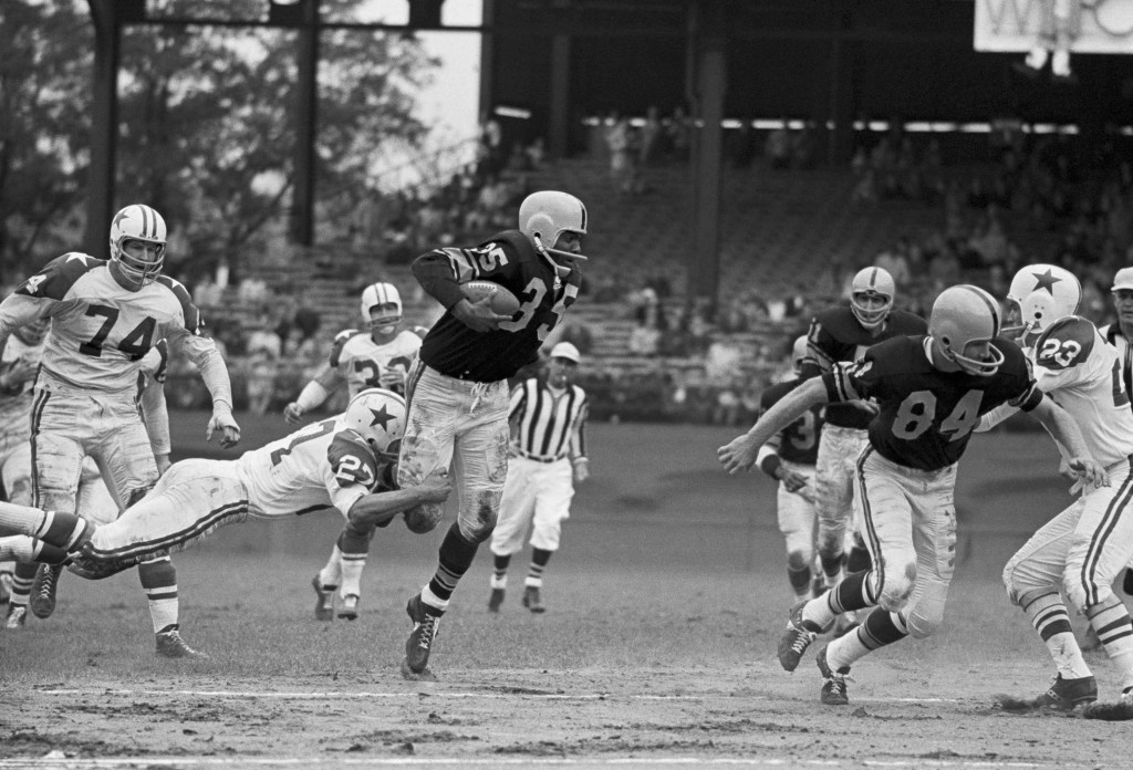 John Henry Johnson, with the Steelers, is chased by fellow Hall-of-Famer Bob Lilly of the Cowboys in 1962. -- AP