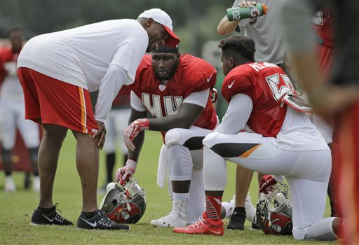 Tampa Bay Buccaneers linebackers coach Hardy Nickerson, left, talks to Courtland Clavette and Kwon Alexander, right, during a Buccaneers training camp practice Tuesday, Aug. 4, 2015, in Tampa, Fla. (AP Photo/Chris O'Meara)