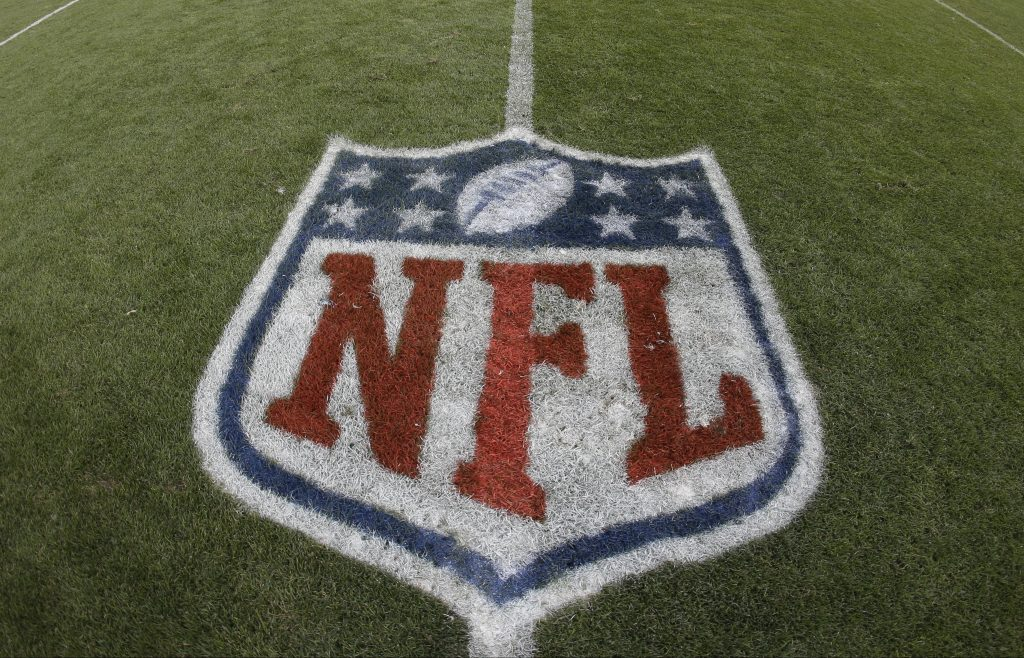 The NFL shield painted on a field