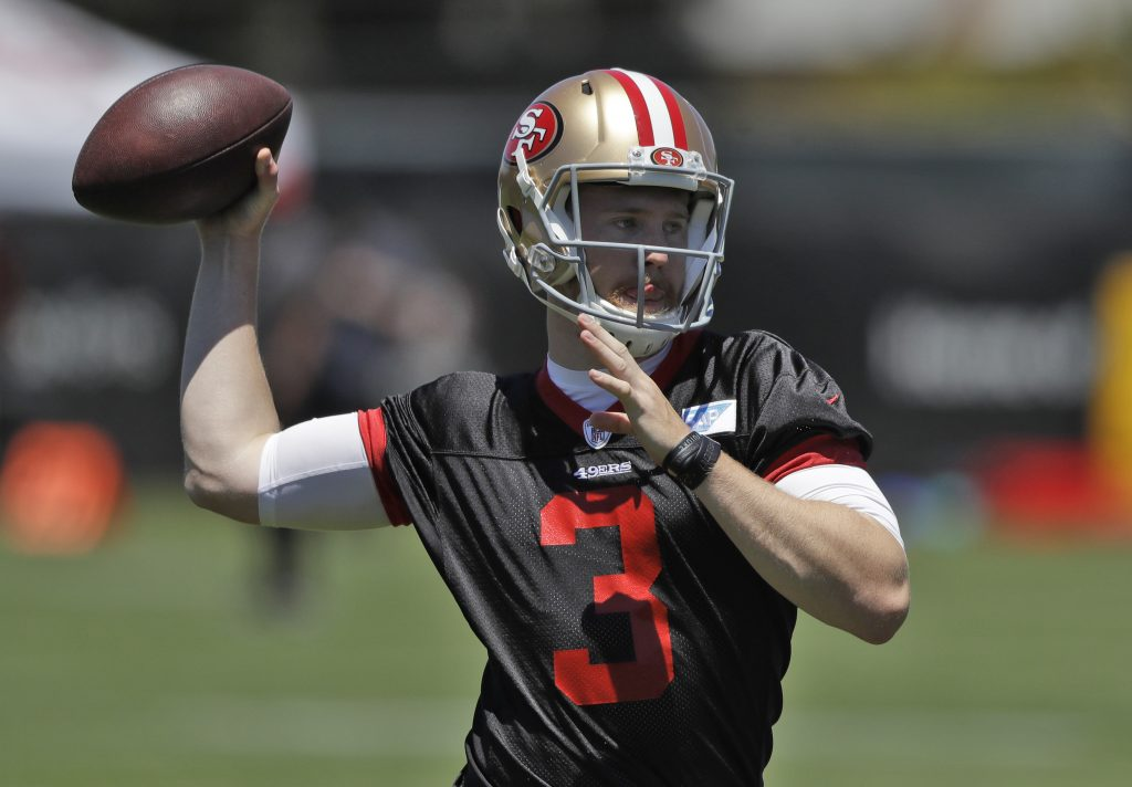 49ers rookie quarterback C.J. Beathard throws a pass during practice
