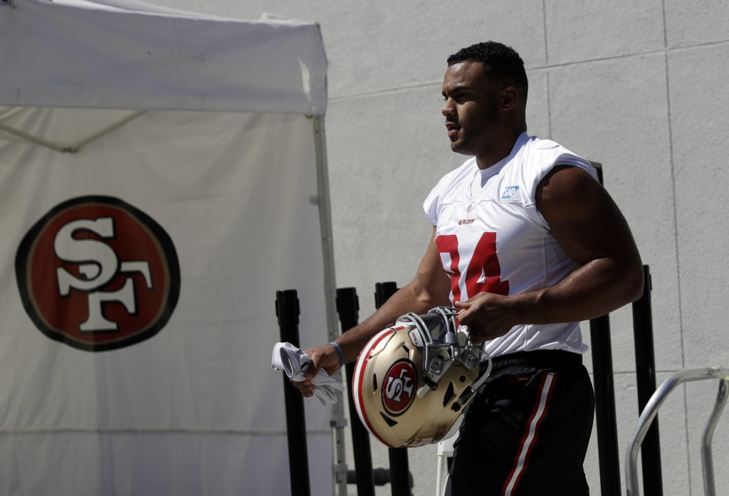 Defensive End Solomon Thomas walks to the practice field during 49ers training camp
