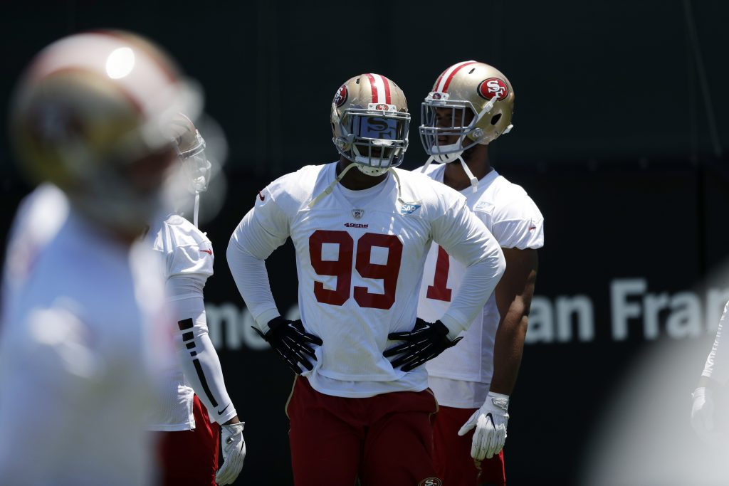 Defensive tackle DeForest Buckner warms up during 49ers training camp