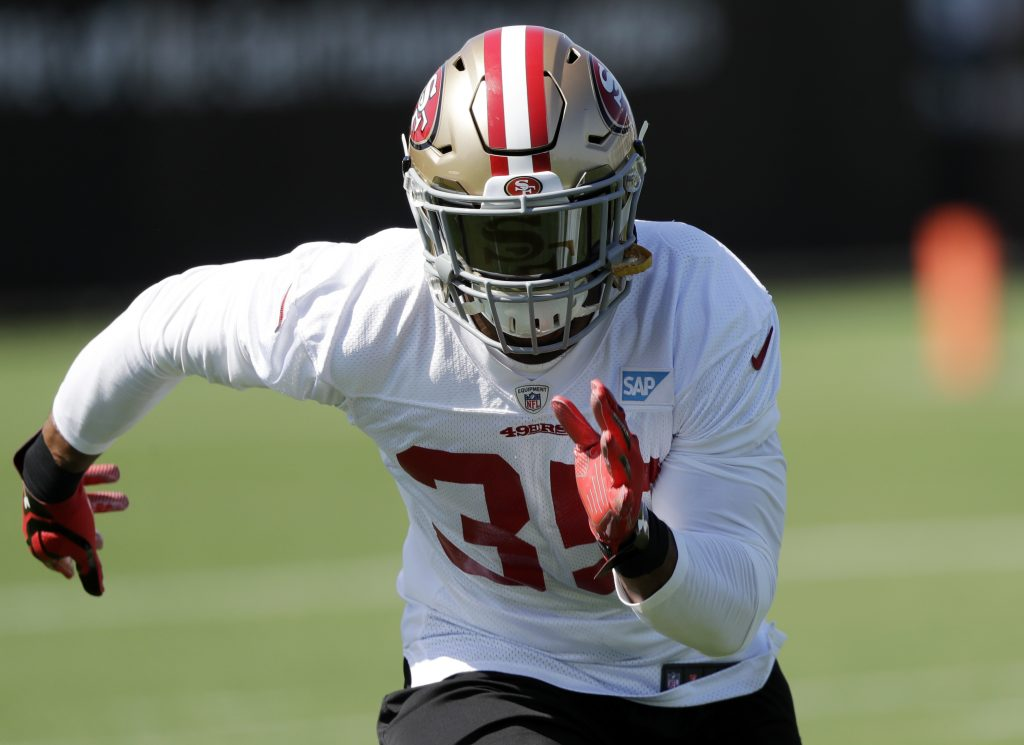 Safety Eric Reid warms up during 49ers training camp