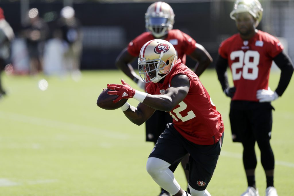 Running back Joe Williams catches a ball during 49ers training camp