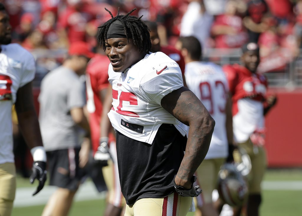 b9c50a6b3 The 49ers offense dekes Reuben Foster during his first practice with the  starters