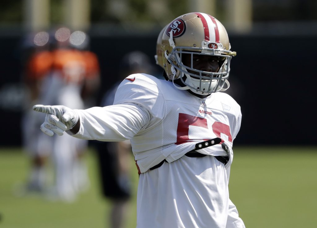 49ers linebacker Reuben Foster points during practice