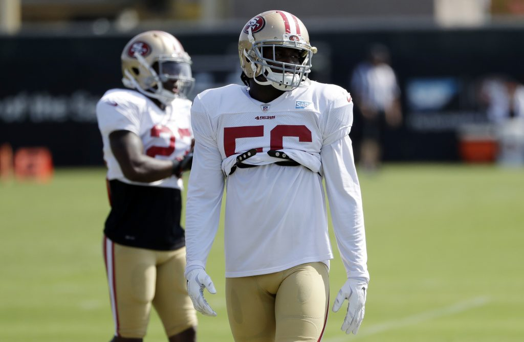 49ers linebacker Reuben stands on the field during practice