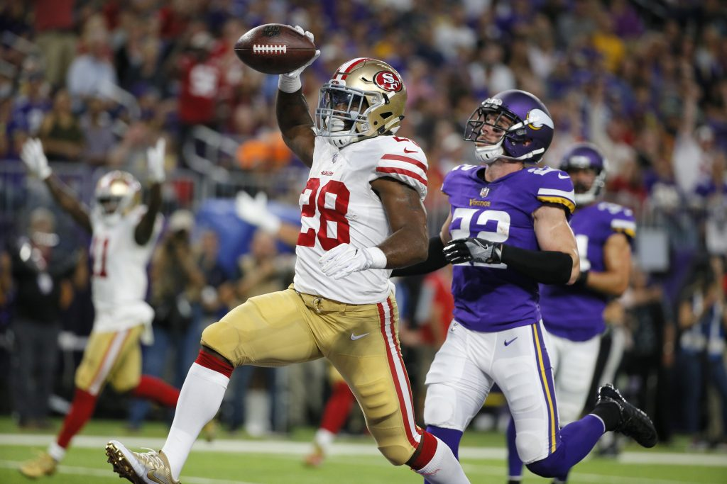 Running back Carlos Hyde runs into the end zone during the 49ers preseason game against the Vikings