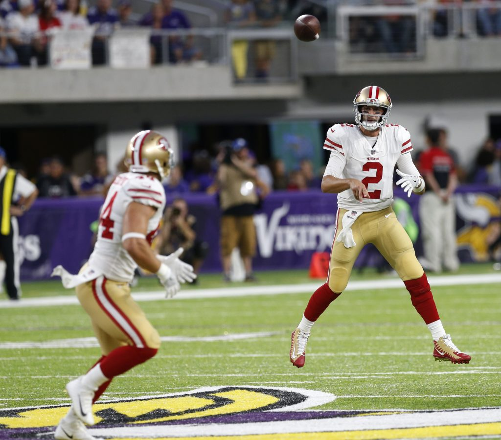 Quarterback Brian Hoyer throws a pass to fullback Kyle Juszczyk.