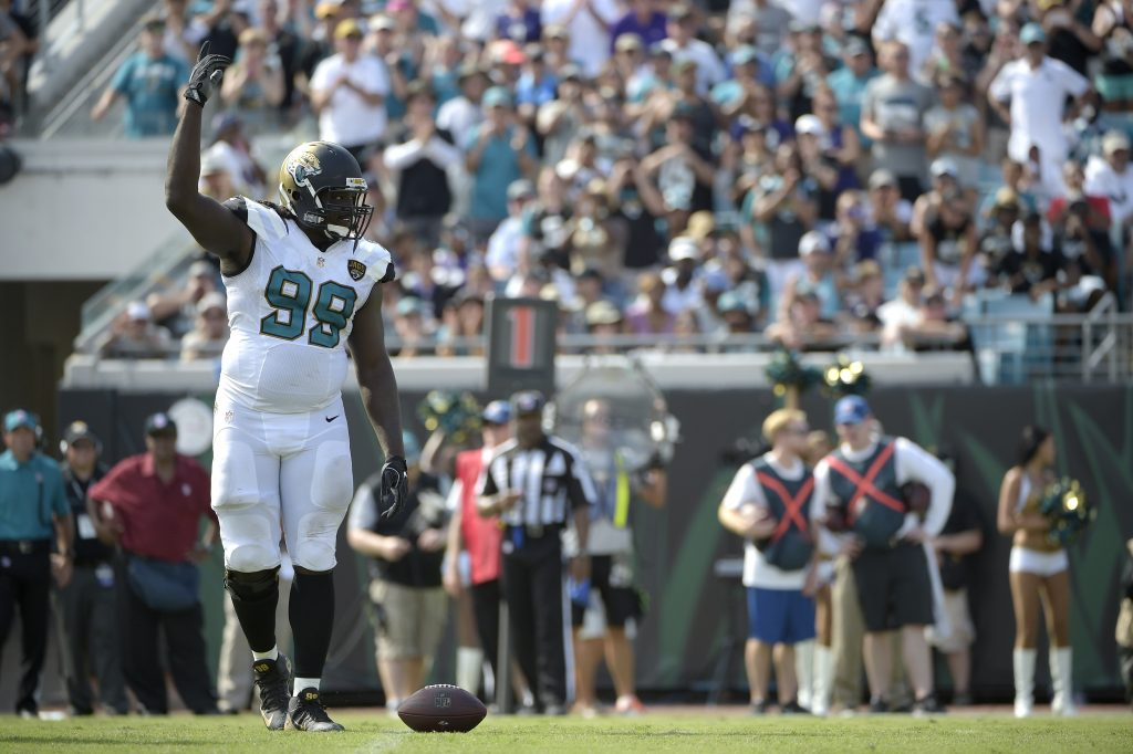 Former Jaguars defensive tackle Sen'Derrick Marks raises his arm
