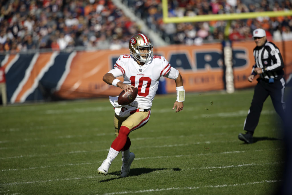d2ca62443 San Francisco 49ers quarterback Jimmy Garoppolo (10) scrambles during the  first half of an NFL football game against the Chicago Bears