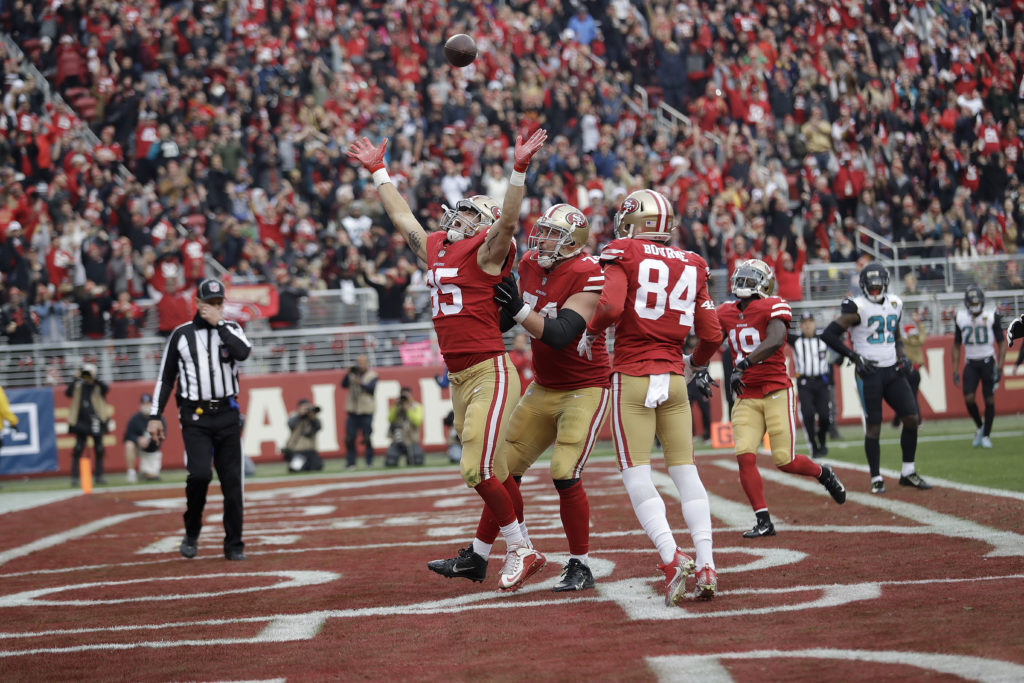 754e8d3f2c4 San Francisco 49ers tight end George Kittle (85) celebrates after scoring a  touchdown against the Jacksonville Jaguars during the second half of an NFL  ...