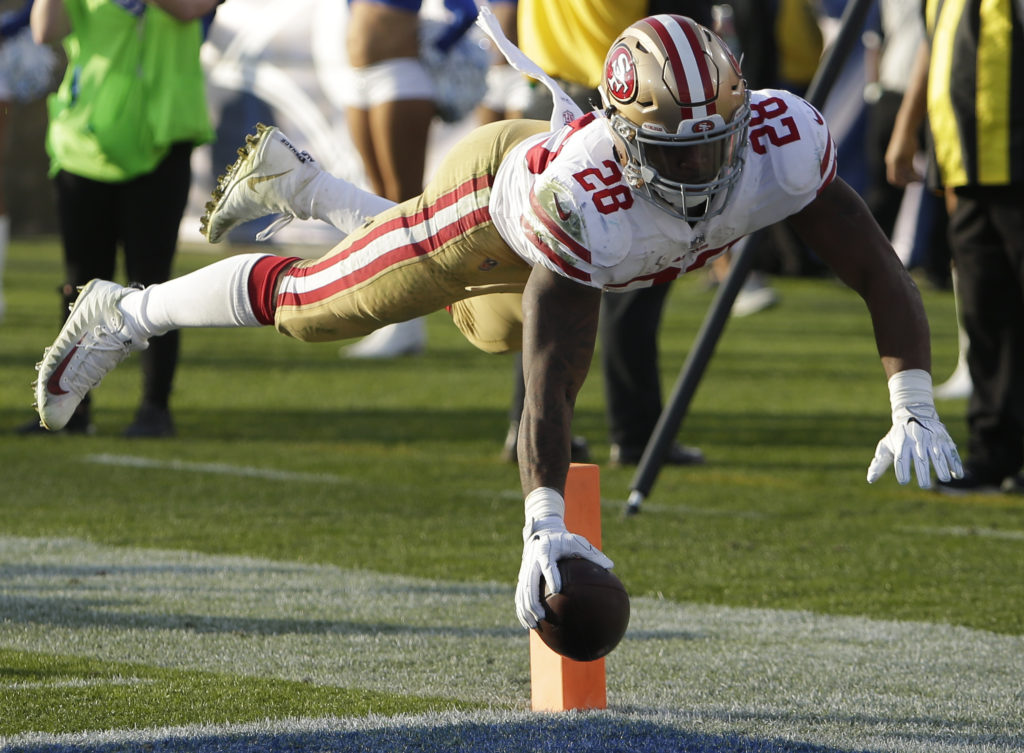 f0c59cbeba1 San Francisco 49ers running back Carlos Hyde scores against the Los Angeles  Rams during the second half of an NFL football game Sunday