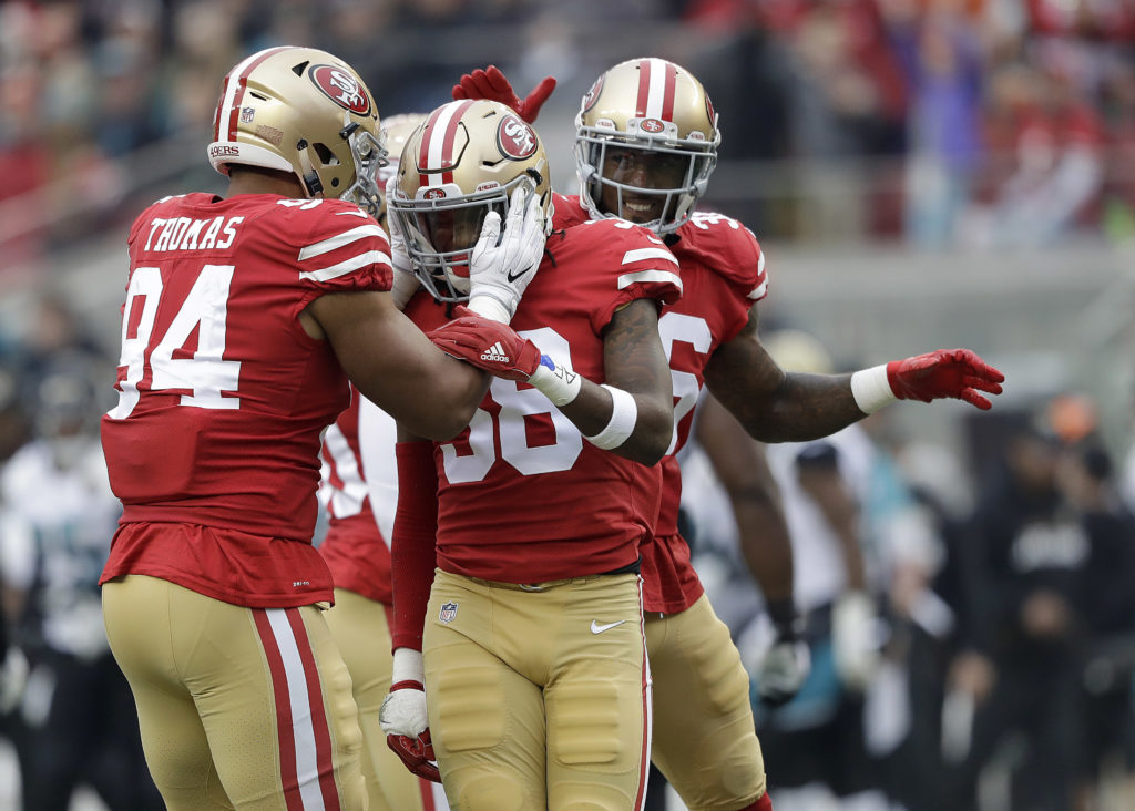 a7bcf5f41ee San Francisco 49ers defensive end Solomon Thomas (94) celebrates with  defensive back Adrian Colbert (38) and cornerback Dontae Johnson (36)  during the first ...