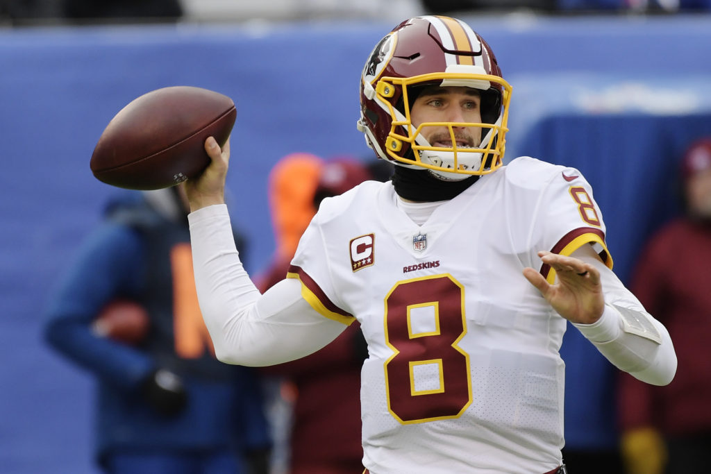 Washington Redskins quarterback Kirk Cousins (8) throws a pass during the  first half of an NFL football game against the New York Giants, Sunday, Dec.