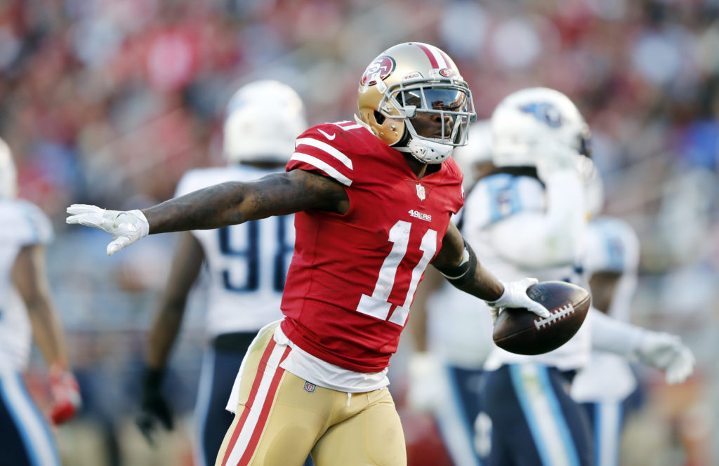 936e17f52f3 San Francisco 49ers wide receiver Marquise Goodwin (11) celebrates after  making a catch against the Tennessee Titans during the second half of an  NFL ...