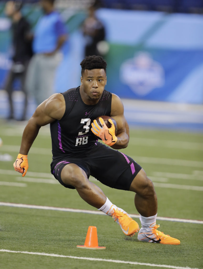 686c8a6bd Penn State running back Saquon Barkley runs a drill during the NFL football  scouting combine