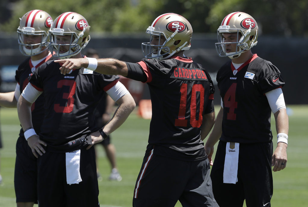 fc8e2fbf9 San Francisco 49ers quarterback Jimmy Garoppolo (10) gestures in front of  C.J. Beathard (3) and Nick Mullens (4) during NFL football practice at the  team s ...