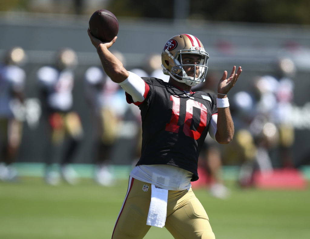 e97be169e54 San Francisco 49ers quarterback Jimmy Garoppolo passes during NFL football  practice at the team s headquarters Thursday