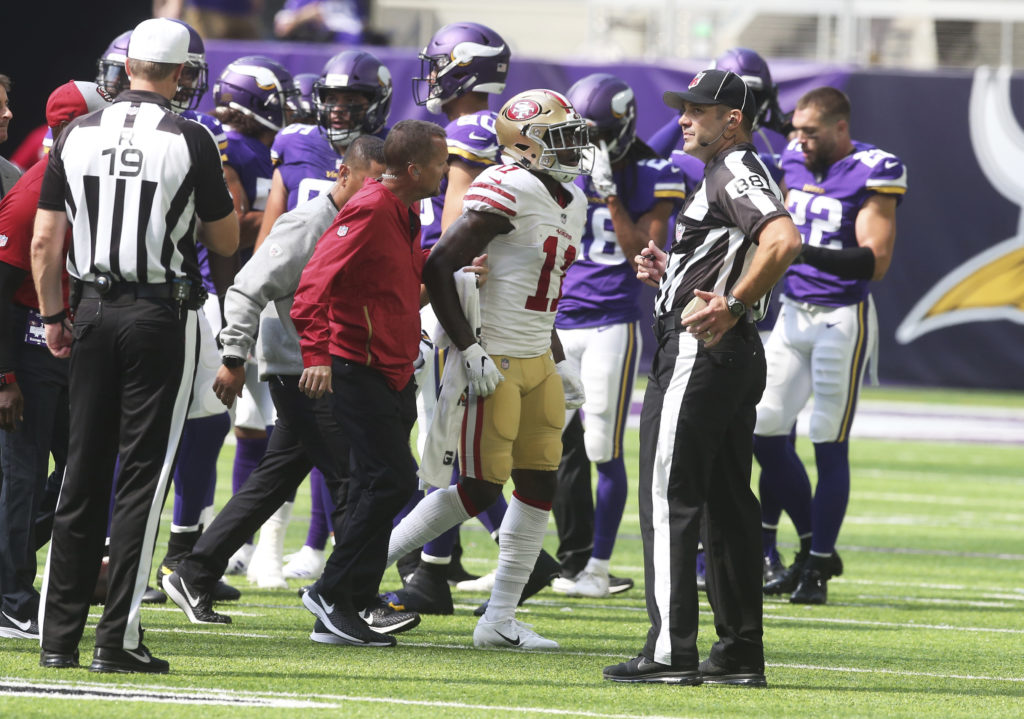 8c3e0d89cb0 San Francisco 49ers wide receiver Marquise Goodwin (11) is helped off the  field after getting injured during the first half of an NFL football game  against ...