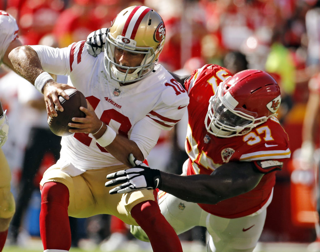 8ae22ceec San Francisco 49ers quarterback Jimmy Garoppolo (10) is tackled by Kansas  City Chiefs defensive lineman Allen Bailey (97) during the second half of  an NFL ...