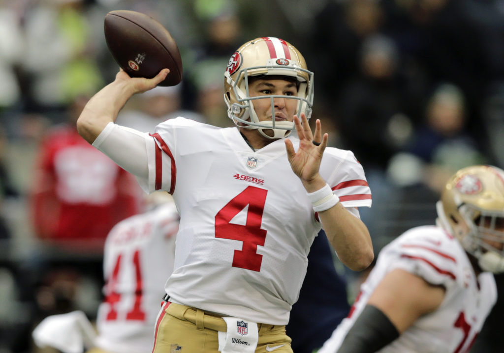 44e042452800 San Francisco 49ers quarterback Nick Mullens passes against the Seattle  Seahawks during the first half of an NFL football game