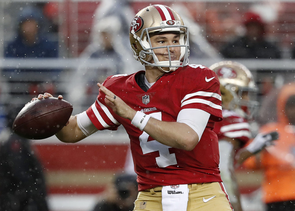 2c914fdd2 San Francisco 49ers quarterback Nick Mullens (4) passes against the Seattle  Seahawks during the second half of an NFL football game in Santa Clara