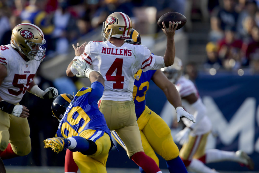 fca3ad2f51b109 Los Angeles Rams defensive end Aaron Donald (99) dives after San Francisco  49ers quarterback Nick Mullens during the first half in an NFL football  game ...