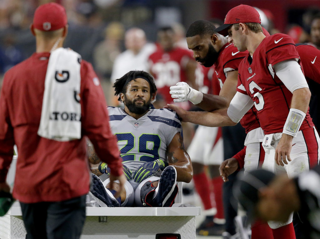 7ec26ea2c ... Earl Thomas (29) is greeted by Arizona Cardinals players as he leaves  the field after breaking his leg during the second half of an NFL football  game
