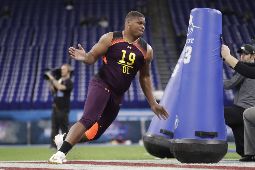 48bec57026d2 Alabama defensive lineman Quinnen Williams runs a drill at the NFL football  scouting combine in Indianapolis